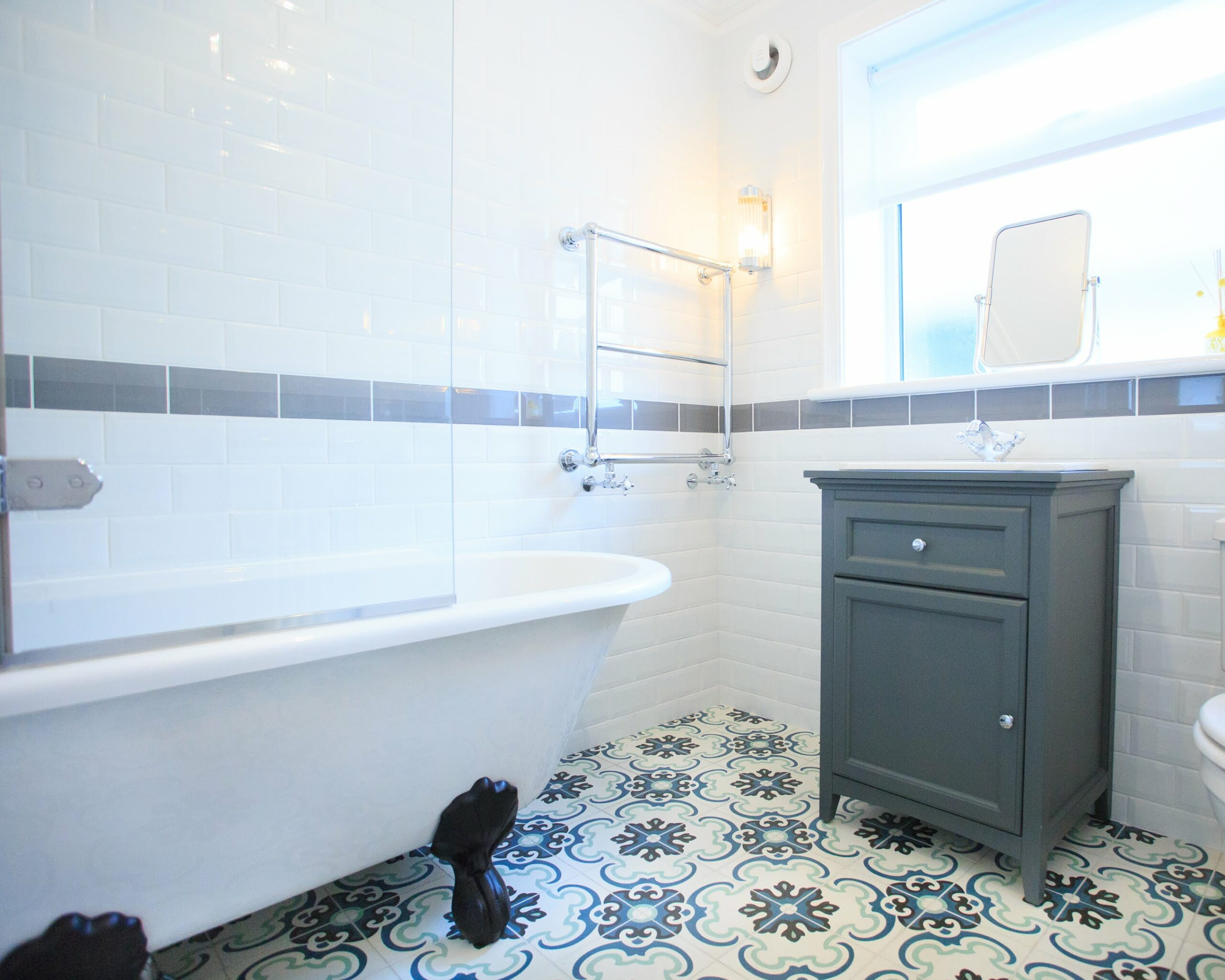 Victorian style bathroom, patterned floor tiles, white wall tiles, roll top bath